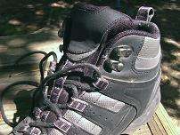 hiking boots with webbing and hooks for the laces